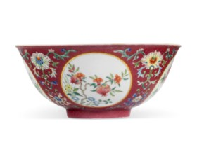 A FAMILLE ROSE SGRAFFIATO RUBY-GROUND MEDALLION BOWL