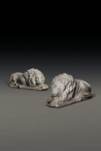 A PAIR OF LIFESIZE ITALIAN MARBLE RECUMBANT LIONS