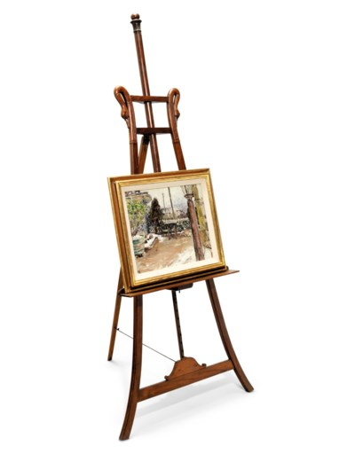 A WOODEN GALLERY EASEL