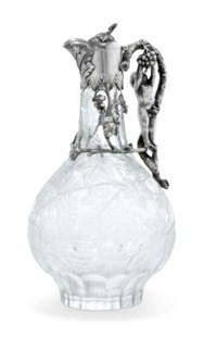 A PARCEL-GILT SILVER-MOUNTED CUT-GLASS DECANTER