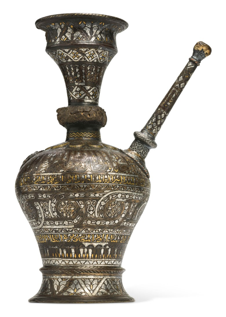 A Mamluk silver, gold and black composition inlaid brass ewer, probably Egypt, period of Sultan Al-Malik al-Nasir Muhammad ibn Qalawun, 1293-4, 1299-1309 and 1310-1341. 18¾ in (47.5 cm) high. Sold for £791, 250 in Art of the Islamic and Indian World including Oriental Rugs and Carpets on 25 June 2020 at Christie's in London