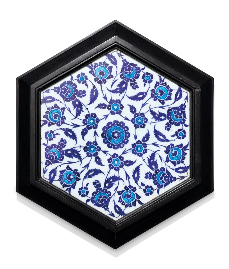 A blue and white hexagonal Iznik tile, Ottoman Turkey, circa 1530. 10½ in (26.5 cm) diam. Estimate £6,000-8,000. Offered in Art of the Islamic and Indian Worlds Including Oriental Rugs and Carpets on 25 June 2020 at Christie's in London