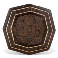 AN IVORY-INLAID CARVED WOODEN