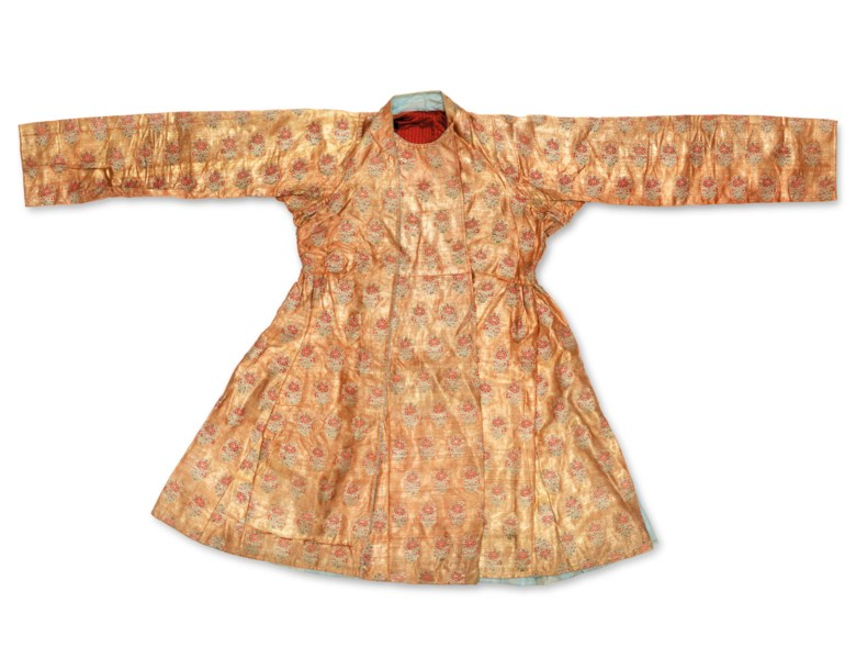 A rare gold brocade robe, Mughal India, circa 1700. Gold and silk threads, brocaded, the gold ground decorated with a repeating design of red floral sprays, red and blue silk lining. 38 in (96.5 cm) long. Estimate £30,000-40,000. Offered in Art of the Islamic and Indian Worlds Including Oriental Rugs and Carpets on 28 October 2020 at Christie's in London