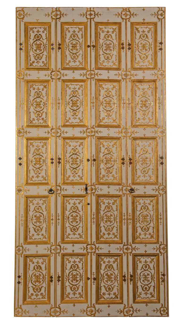 Palazzo Reale, Turin parcel-gilt and cream painted folding boiserie panels or window shutters, early 18th century. Each panel 127¼ in (323 cm) high; the two inner panels 15¼ in (39 cm) wide; the two outer panels 17¼ in (44 cm) wide, the decorated surface approx 63⅛ in (160.5 cm) wide in total. Estimate £15,000-25,000. Offered in Works of Art from The Giuseppe Rossi