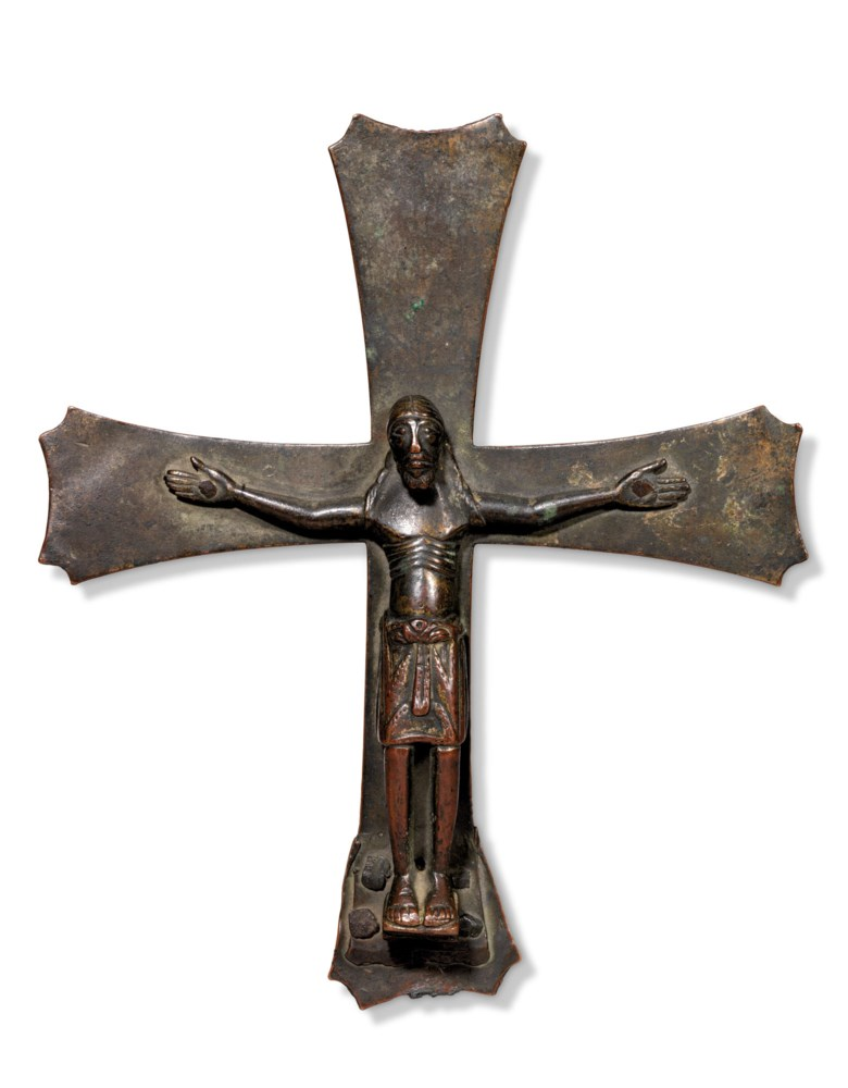 Italian, second half of the 12th century, Christ crucified. Bronze. 10¾ in (27.2 cm) high; 9 in (23 cm) wide. Estimate £5,000-8,000. Offered in Works of Art from The Giuseppe Rossi Collection Sold to Benefit a Charity, 24 September to 15 October 2020, online