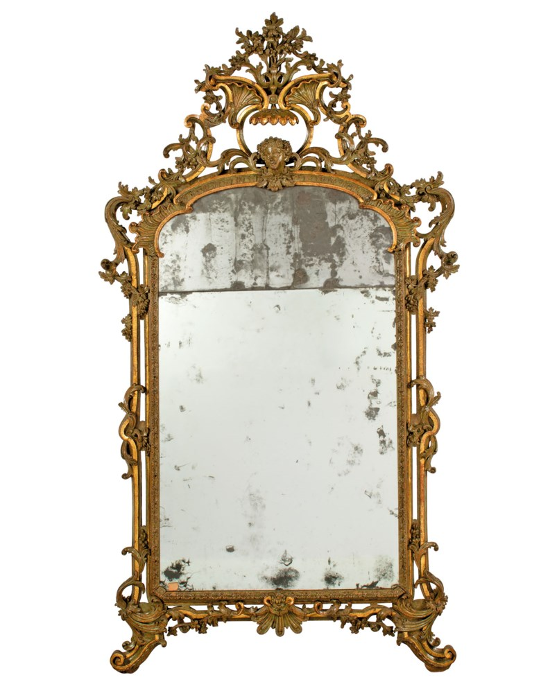A north Italian green-painted and parcel-gilt mirror, mid-18th century, possibly by Gian Pietro Baroni di Tavigliano. 79 in (201 cm) high; 43¾ in (111 cm) wide. Estimate £10,000-15,000. Offered in Works of Art from The Giuseppe Rossi Collection Sold to Benefit a Charity, 24 September to 15 October 2020, online