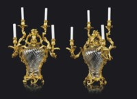 A PAIR OF FRENCH ORMOLU-MOUNTED CUT-CRYSTAL-GLASS FOUR-LIGHT VASE-CANDELABRA