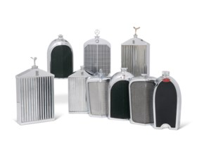 A GROUP OF NINE CHROMIUM-PLATED NOVELTY FLASKS