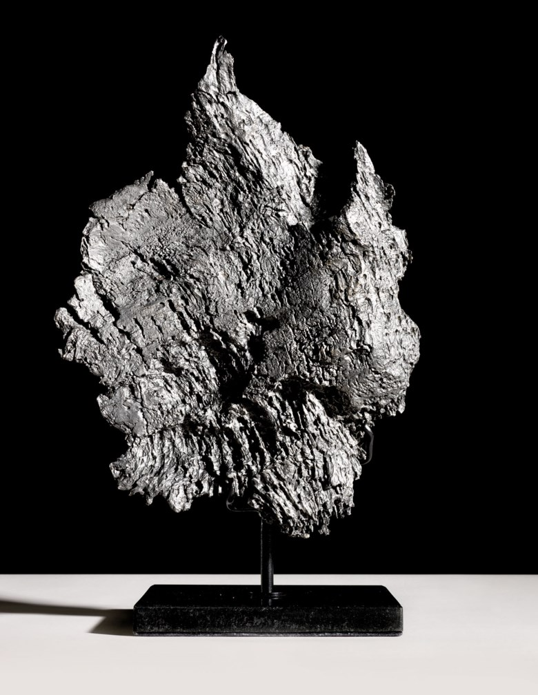 A large dronino meteorite, Ryazan district, Russia. Iron, ataxite (ungrouped). 18½ x 18½ x 7¾ in (47 x 47 x 20 cm) on stand. Estimate £7,000-10,000. Offered in  Sculpted by Nature Fossils, Minerals and Meteorites, 14-28 October 2020, Online