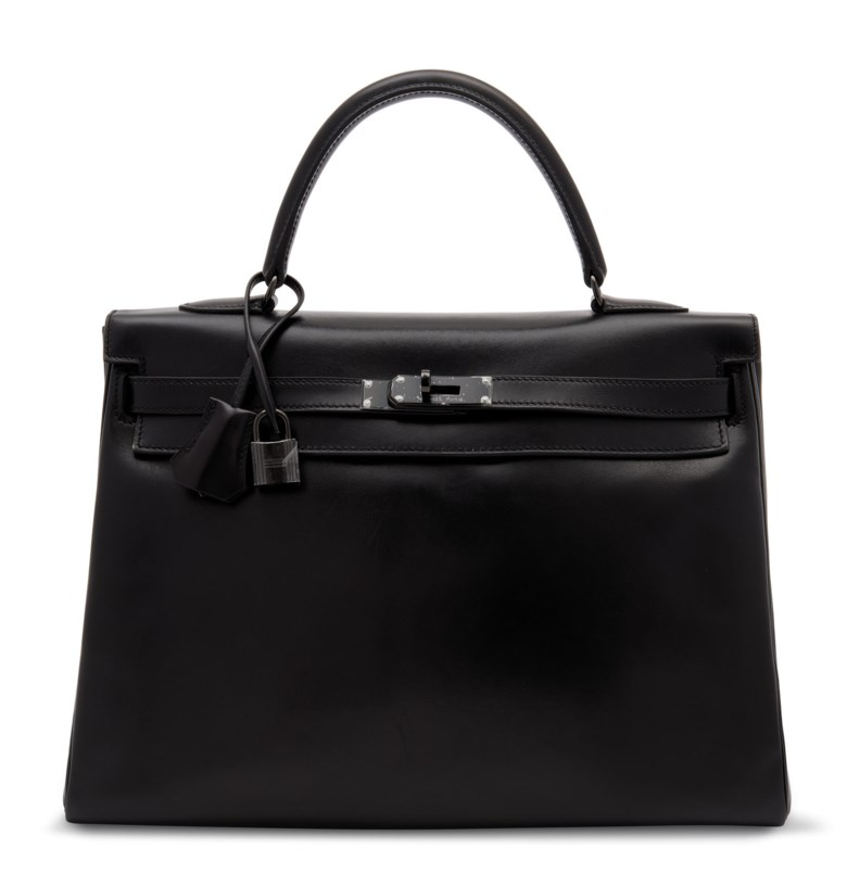 A limited edition black calf box leather retourné So Black Kelly 35 with black PVD hardware, Hermès, 2011. 35 w x 25 h x 13 d cm. Sold for £16,250 in Handbags & Accessories on 31 July 2020 at Christie's in London