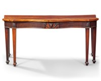 A GEORGE III MAHOGANY SERPENTINE SERVING-TABLE