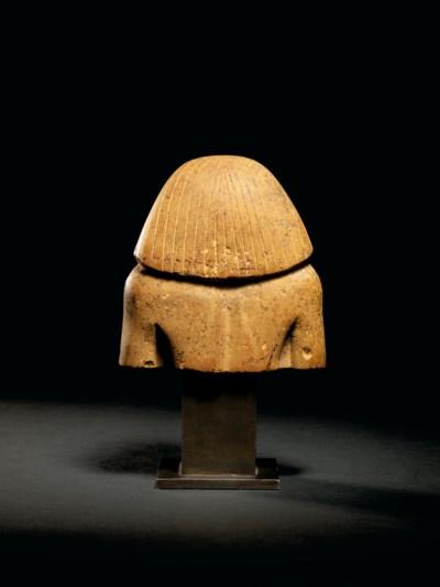 AN EGYPTIAN YELLOW LIMESTONE B