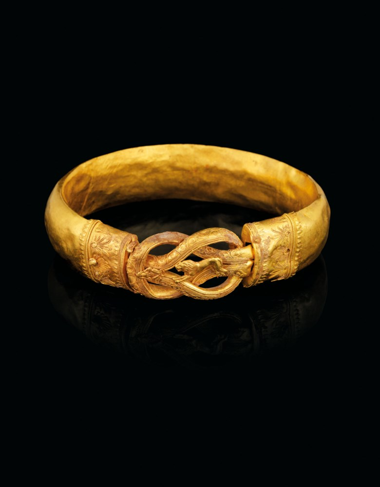A Greek gold armlet, Hellenistic period, circa 300 BC. 4  in (10.2 cm) wide. Estimate £80,000-120,000. Offered in Antiquities on 16 December 2020 at Christie's in London