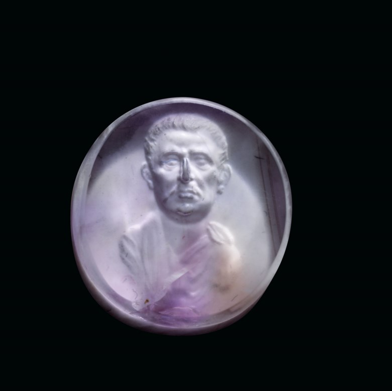 A Roman pale amethyst ringstone with male portrait bust, Julio-Claudian period, circa 1st century BC-1st century AD. ¾  in (2  cm) wide. Estimate £40,000-60,000. Offered in Antiquities on 16 December 2020 at Christie's in London