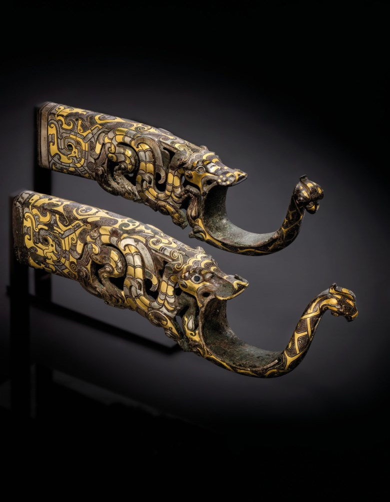 A rare and magnificent pair of gold-and-silver-inlaid bronze chariot fittings, Eastern Zhou dynasty, 4th-3rd century BC. 10¼ in (26 cm) long. Estimate £600,000-1,000,000. Offered in Important Chinese Art on 3 November 2020 at Christie's in London