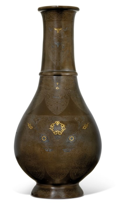 A LARGE SILVER AND GOLD-INLAID