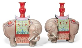 A PAIR OF FAMILLE ROSE 'ELEPHANT AND VASE' CANDLE HOLDERS, T