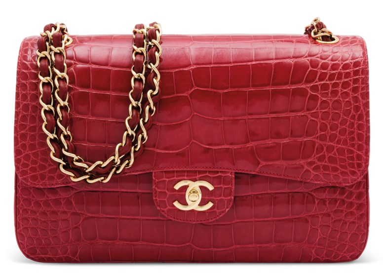 A shiny red alligator jumbo classic double flap with gold hardware, Chanel, 2017. 30 w x 20 h x 9 d cm. Estimate £6,000-8,000. Offered in Handbags Online The London Edition, 9-25 June 2020, Online