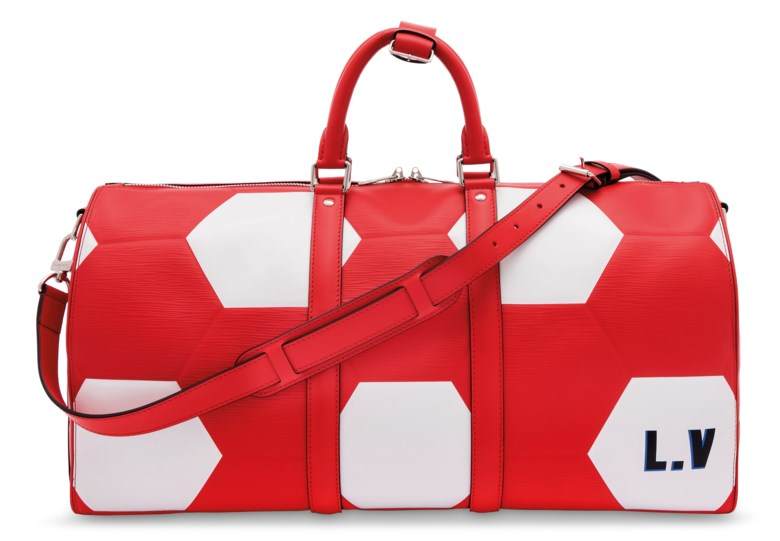 A limited edition FIFA world cup red leather hexagonal Keepall 50 with silver hardware, Louis Vuitton, 2018. 50 w x 26 h x 21 d cm. Estimate £1,500-2,000. Offered in Handbags Online The London Edition, 9-25 June 2020, Online