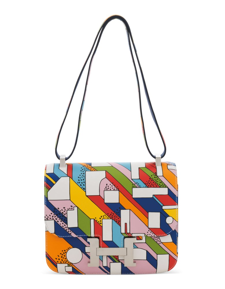 A limited edition multicolor swift leather on a summer day Constance 24 with palladium hardware by Nigel Peake, Hermès, 2017. 24 w x 19 h x 7 d cm . Estimate £8,000-10,000. Offered in Handbags Online The London Edition, 9-25 June 2020, Online