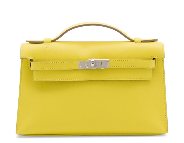 A lime swift leather Kelly pochette with palladium hardware, Hermès, 2019. 22 w x 13 h x 6 d cm. Estimate £4,000-6,000. Offered in Handbags Online The London Edition, 9-25 June 2020, Online