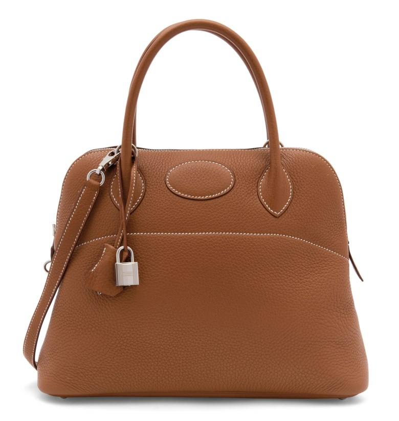 A gold clémence leather Bolide 31 with palladium hardware, Hermès, 2015. 31 w x 24 h x 12 d cm. Estimate £2,000-3,000. Offered in Handbags Online The London Edition, 9-25 June 2020, Online