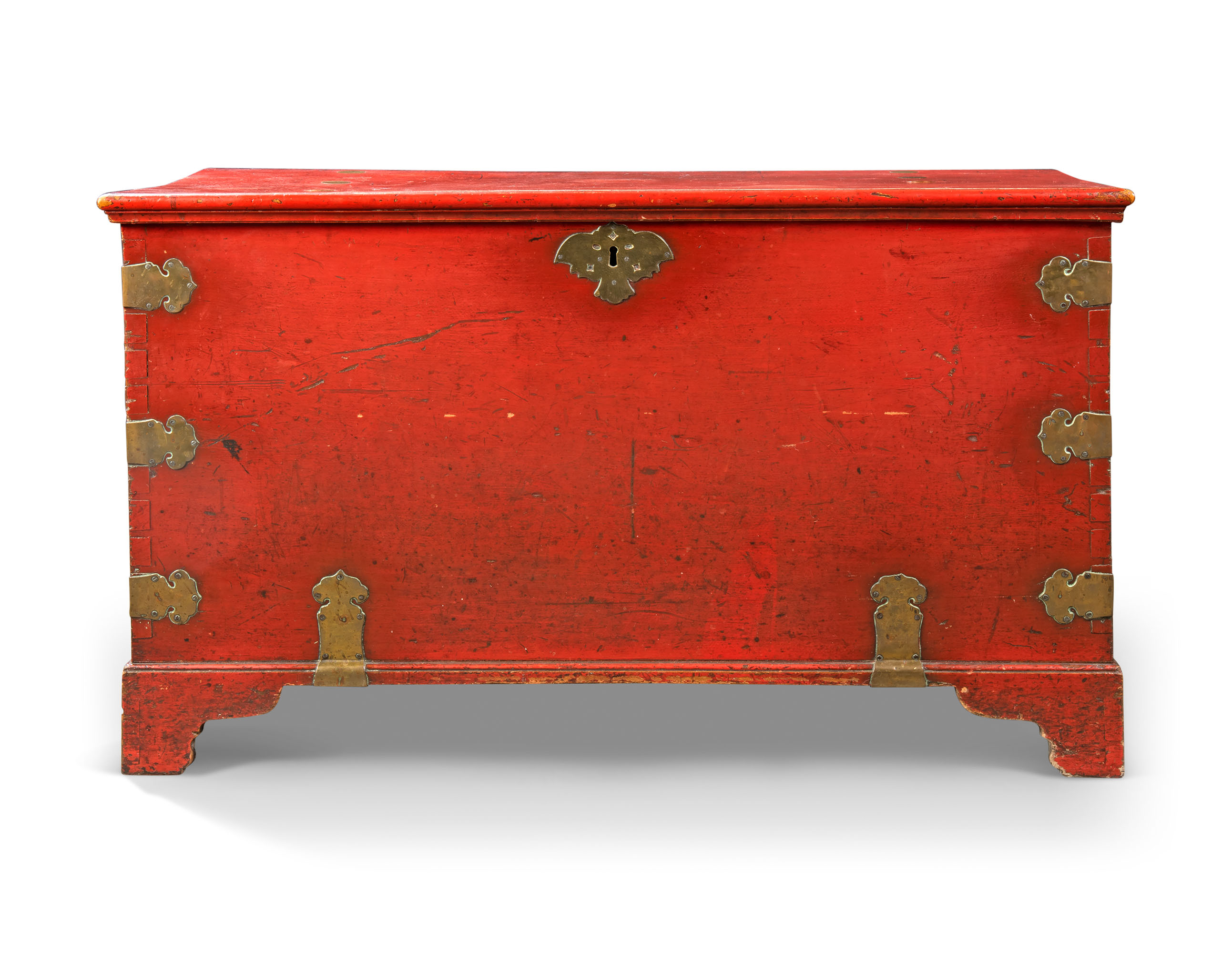 AN INDO-PORTUGUESE BRASS-MOUNTED AND RED-LACQUERED TEAK CHEST