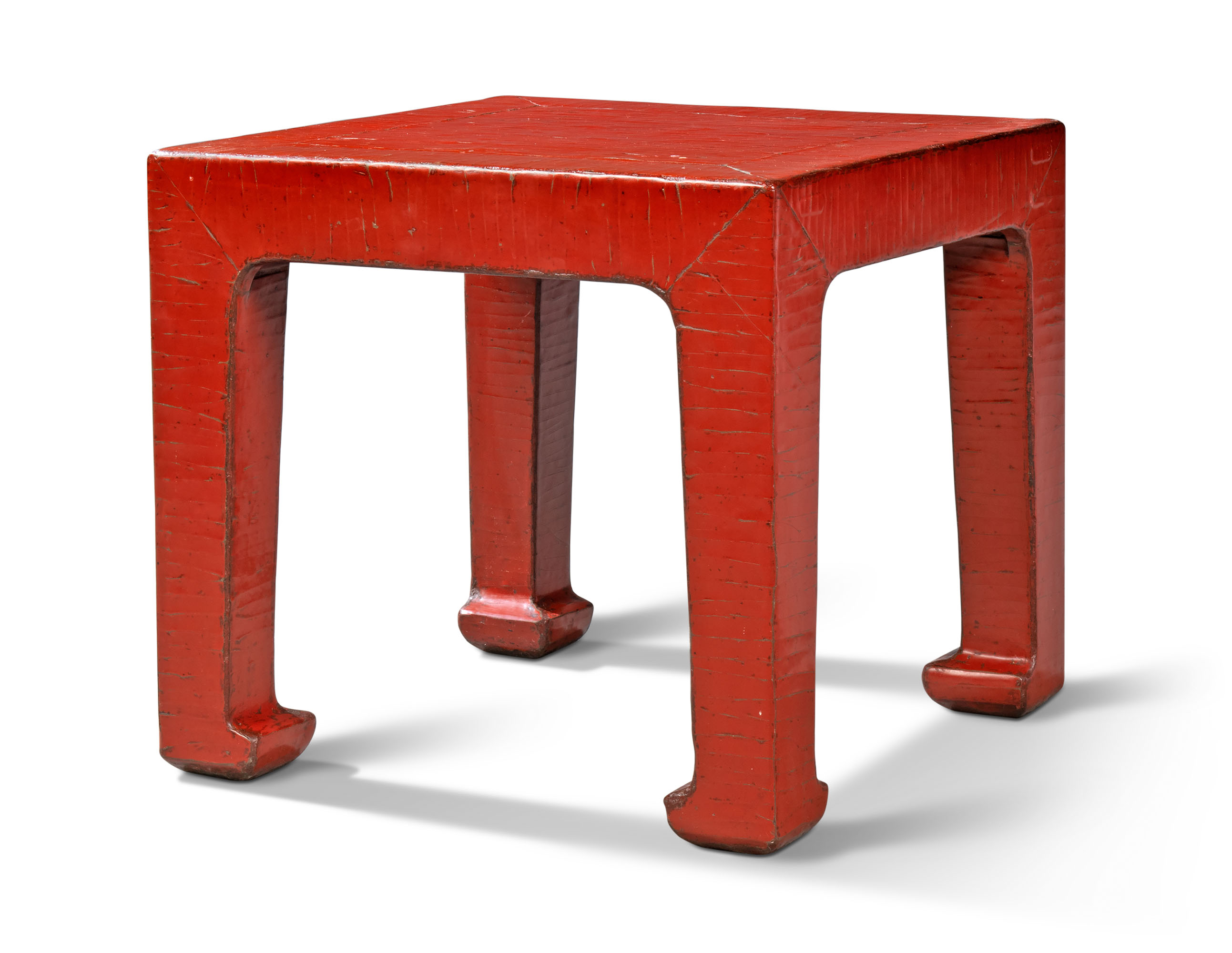 A CHINESE RED-LACQUERED LOW TABLE