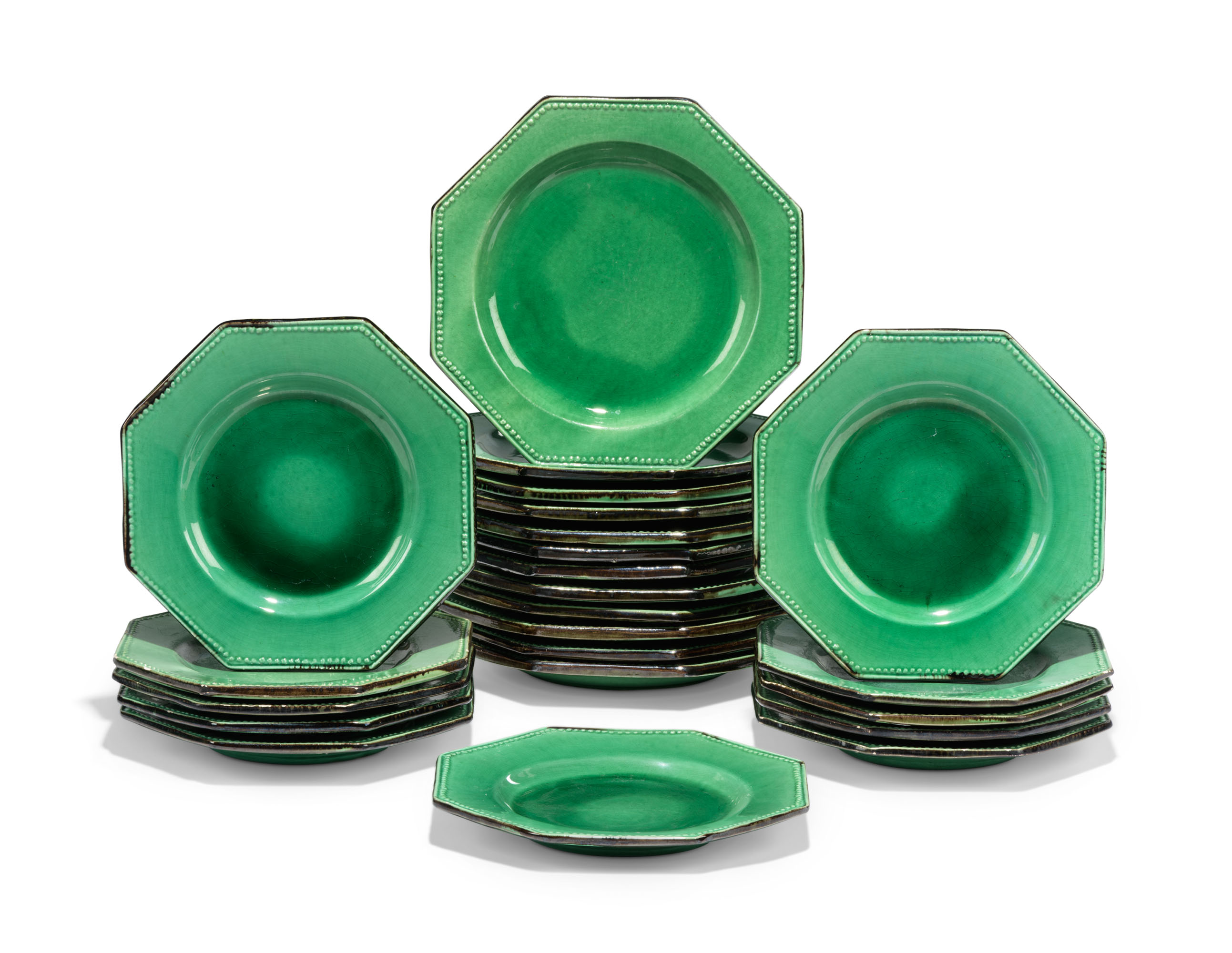 A GROUP OF FRENCH POTTERY GREEN-GROUND OCTAGONAL PLATES