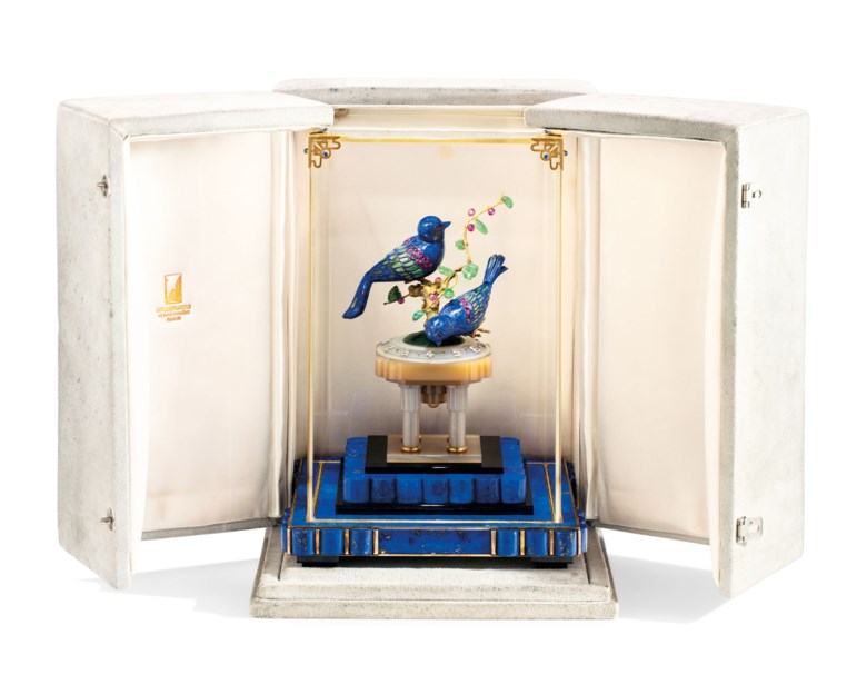 An Art Deco multi-gem desk clock, by Van Cleef & Arpels, 1928. 13.5 x 13.5 x 15 cm. Signed Van Cleef & Arpels, no. 31616, grey Van Cleef & Arpels case. Estimate CHF 250,000-350,000. Offered in Magnificent Jewels on 10 November 2020 at Christie's in Geneva