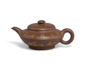 A YIXING GILT-DECORATED AND INSCRIBED TEAPOT