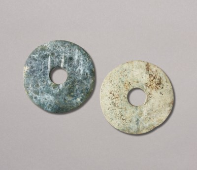 A MOTTLED GREEN JADE DISC AND