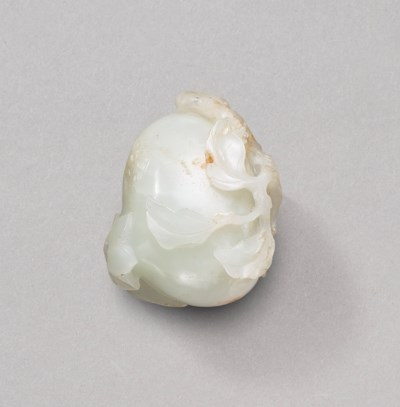 A WHITE JADE 'PERSIMMON' CARVI