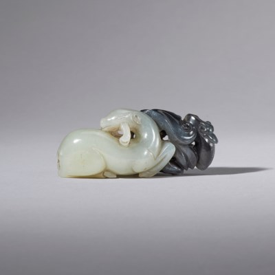 A BLACK AND WHITE JADE CARVING