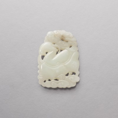 A FINELY CARVED WHITE JADE OPE