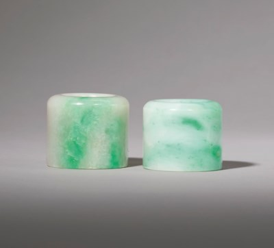 TWO JADEITE ARCHER'S RINGS