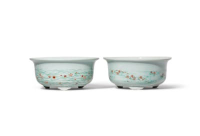 A PAIR OF GREEN ENAMELLED AND