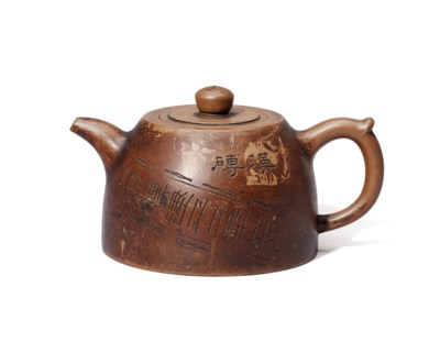 AN INSCRIBED YIXING TEAPOT AND
