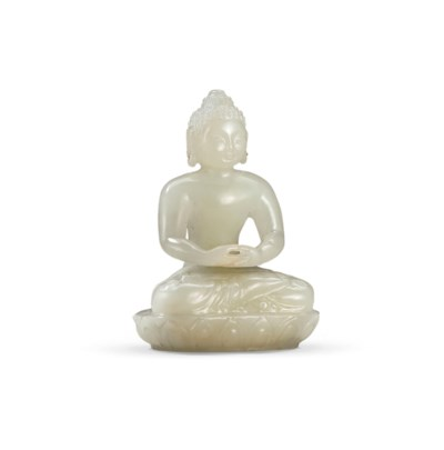 A SMALL WHITE JADE FIGURE OF S