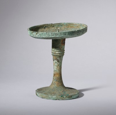 A BRONZE CANDLE STICK HOLDER