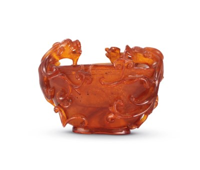 A CARVED AMBER ARCHAISTIC LIBA