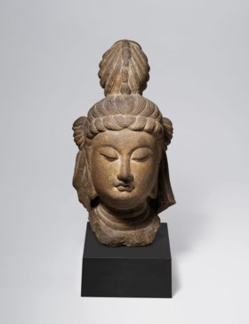 AN EXCEPTIONAL SANDSTONE HEAD OF A BODHISATTVA