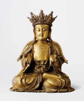 A MAGNIFICENT LARGE AND RARE GILT-BRONZE SEATED FIGURE OF a