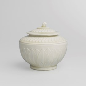 A RARE AND SUPERBLY CARVED DING 'LOTUS' JAR AND COVER
