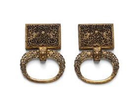 A PAIR OF RETICULATED GILT-BRONZE 'DRAGON' BELT FITTINGS
