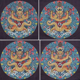 A SET OF FOUR IMPERIAL EMBROIDERED 'DRAGON' ROUNDELS