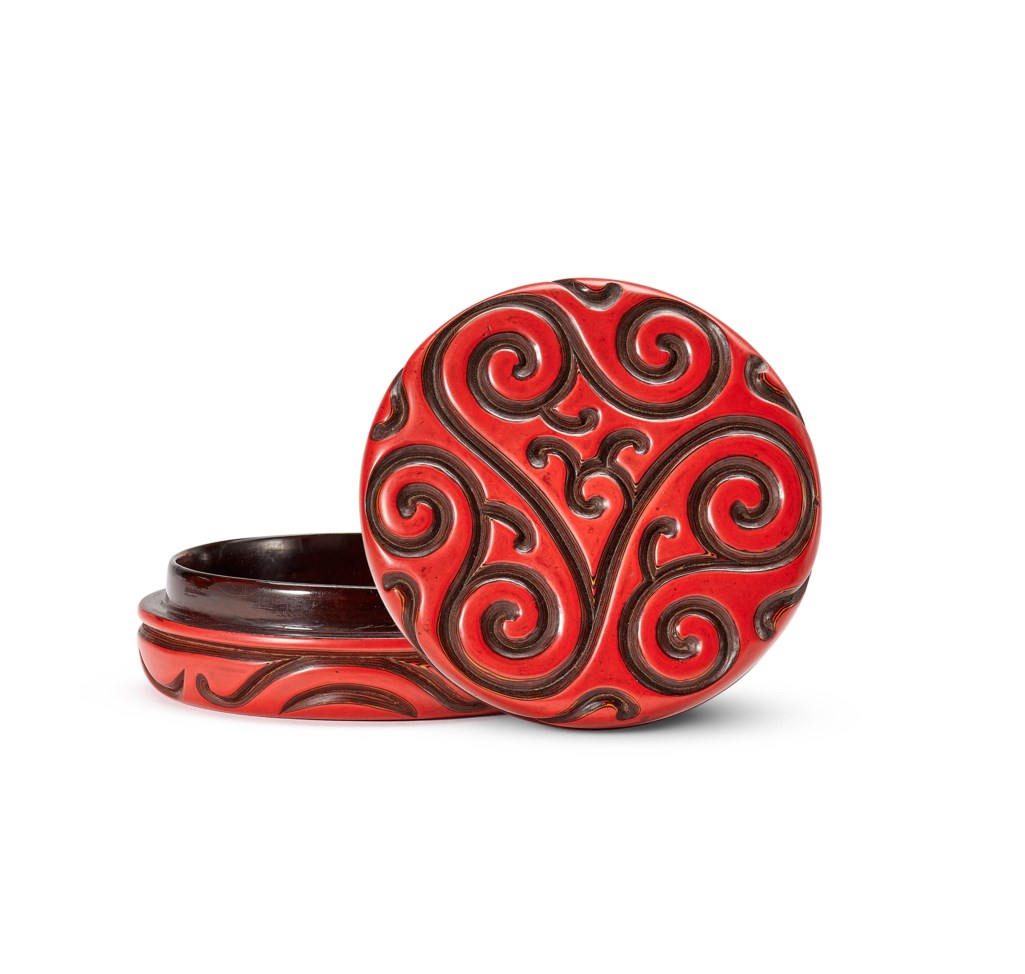 A CARVED TIXI RED LACQUER CIRCULAR BOX AND COVER