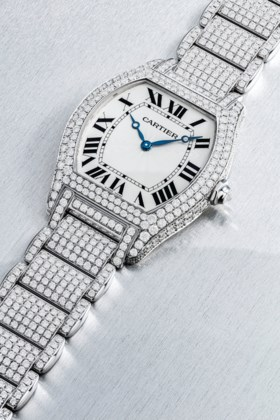 CARTIER A RARE 18K WHITE GOLD AND DIAMOND-SET TONNEAU-SHAPED