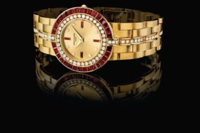PATEK PHILIPPE AN 18K GOLD, DIAMOND AND RUBY-SET BRACELET WA